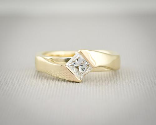 Modern channel set princess cut diamond engagement ring