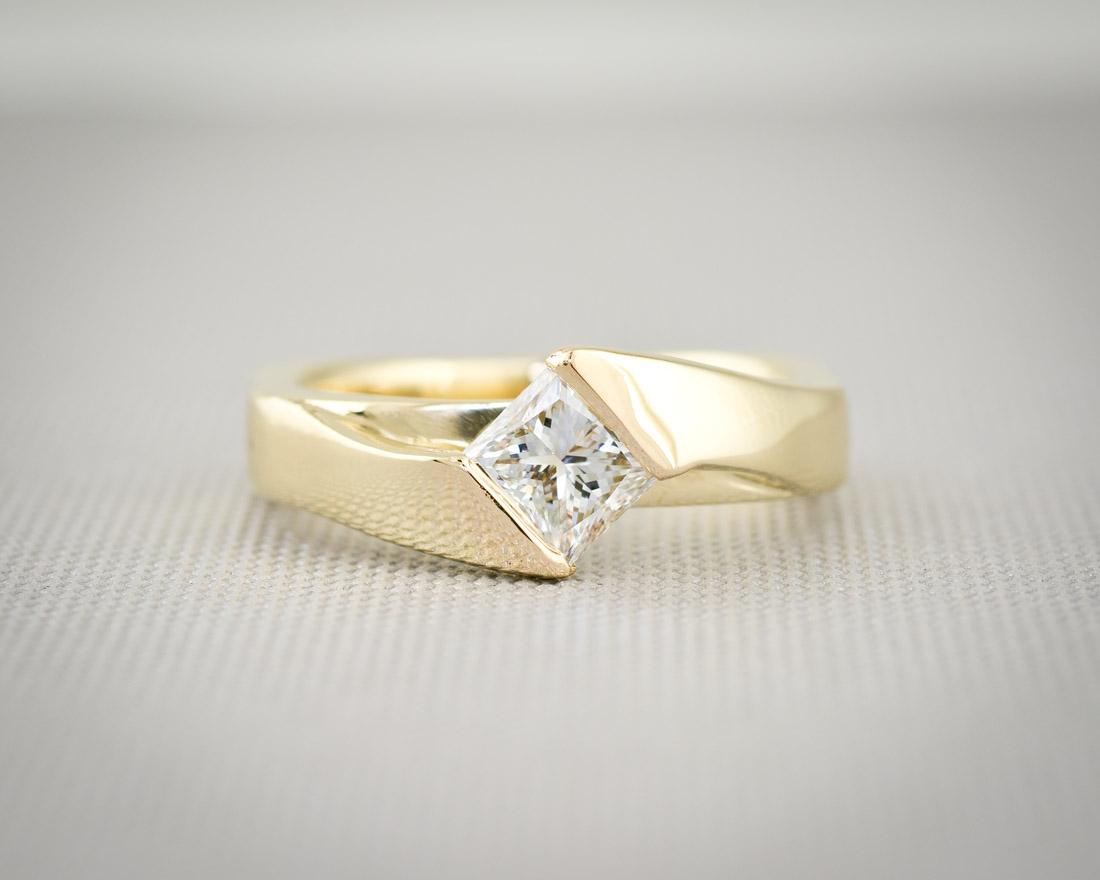 Modern channel set princess cut diamond engagement ring