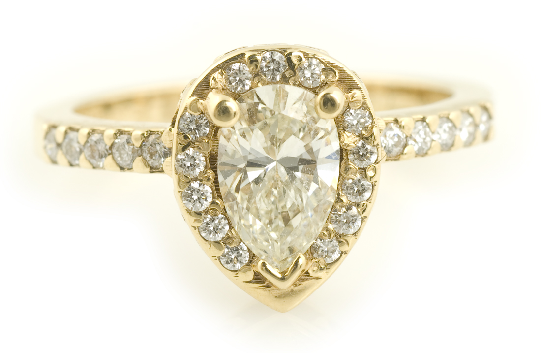 Pear Cut Diamond Halo Engagement Ring in Yellow Gold