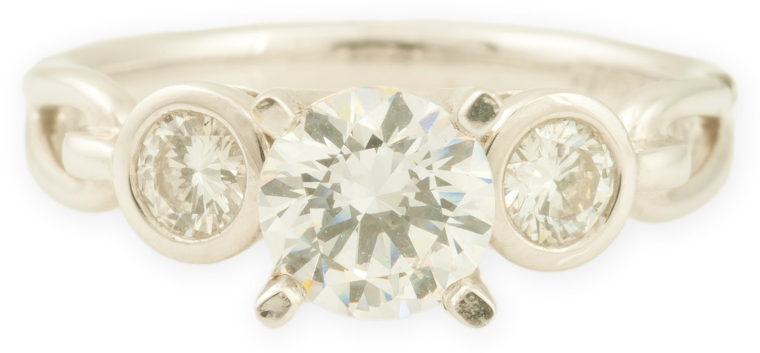 Three Stone Engagement Ring with Bezel Set Diamonds