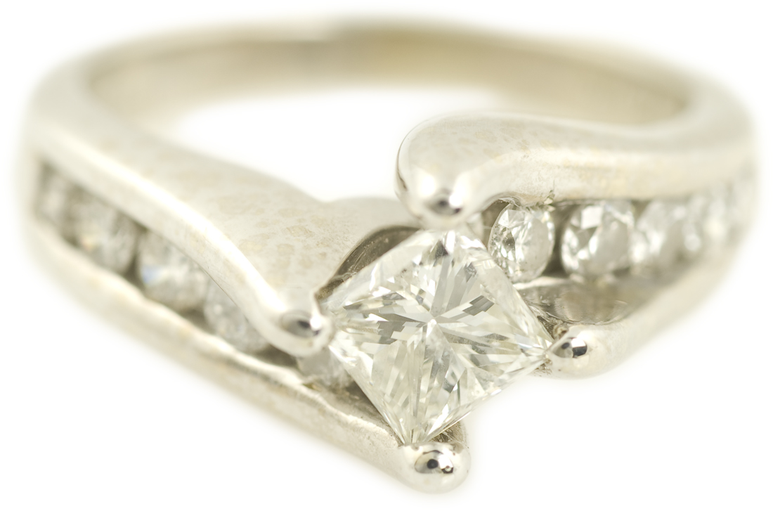 Offset Twisted Princess Cut Engagement Ring With Channel Set Diamonds