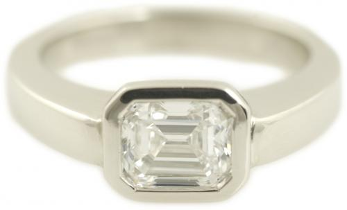 Modern Bezel Set Emerald Cut Diamond Engagement Ring