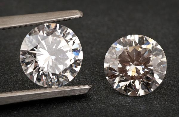 Natural diamond next to lab grown synthetic diamond