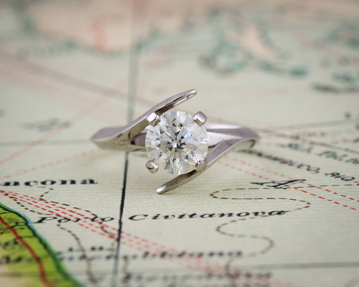 Custom white gold modern solitaire engagement ring front