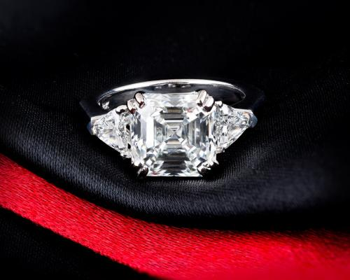 Asscher cut engagement ring with triangel accents
