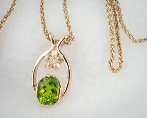Oval peridot mothers pendant