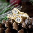 Two stone diamond ring with accent diamonds