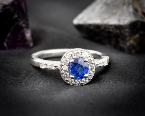 Non-traditional sapphire halo engagement ring