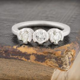 Small three stone diamond band