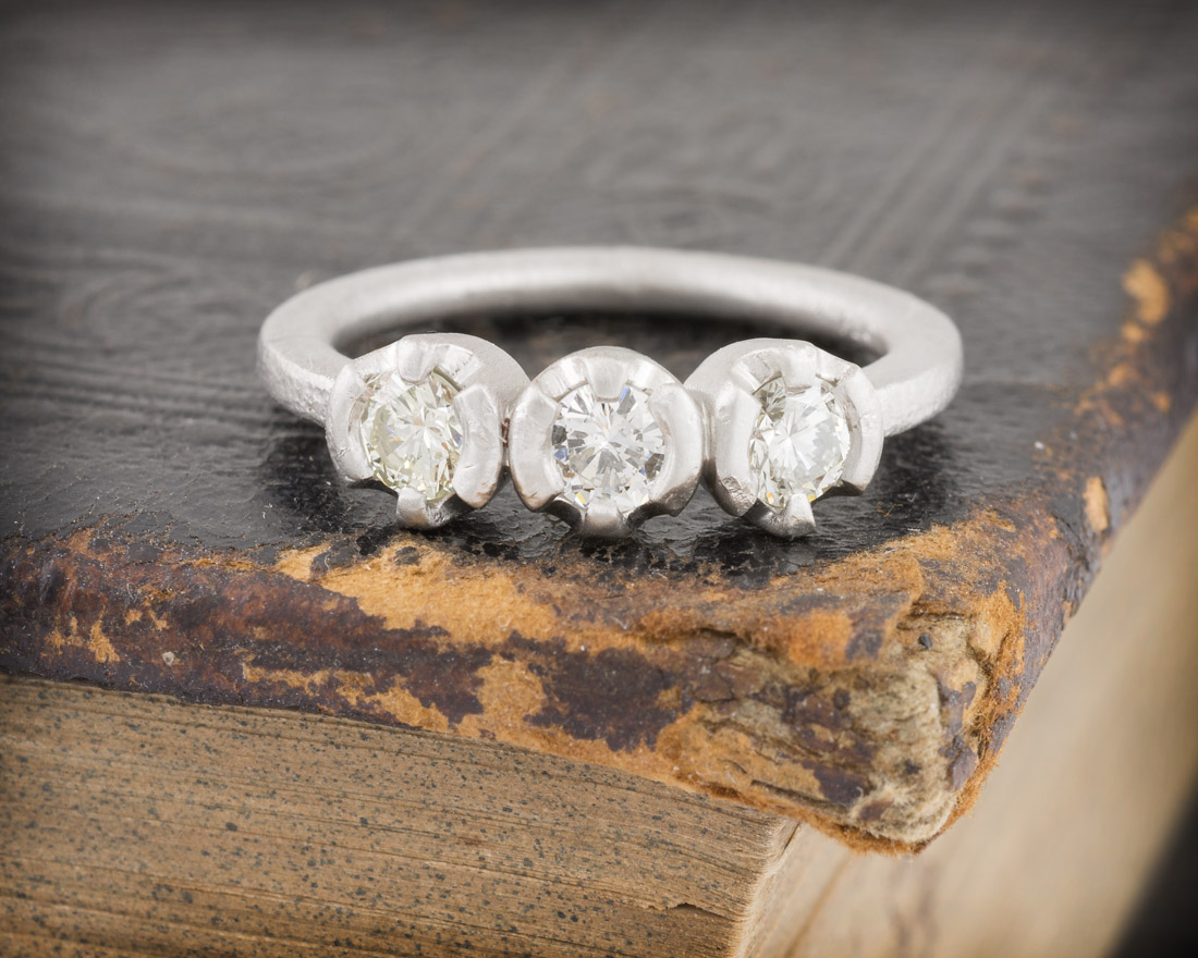 Small three stone diamond band