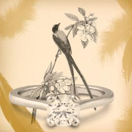 Diamond solitaire engagement ring with artistic bird illustration