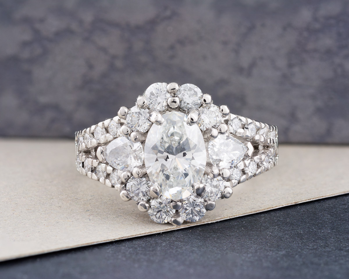 Oval Diamond Engagement Ring with Pear and Round Brilliant Accents