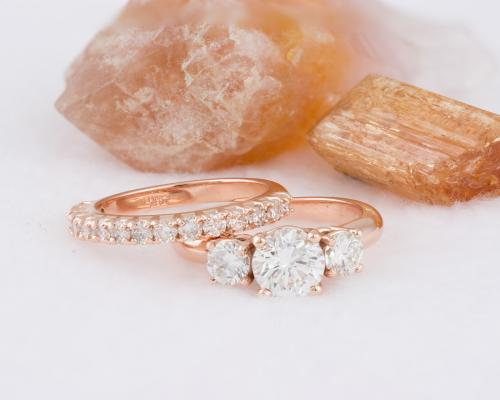 Rose gold three stone ring with diamond band