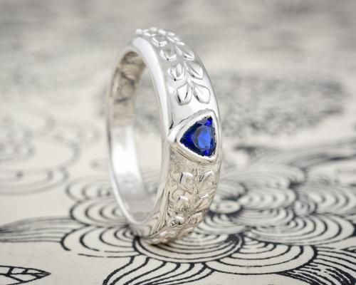 Mens wedding band with triangular sapphire