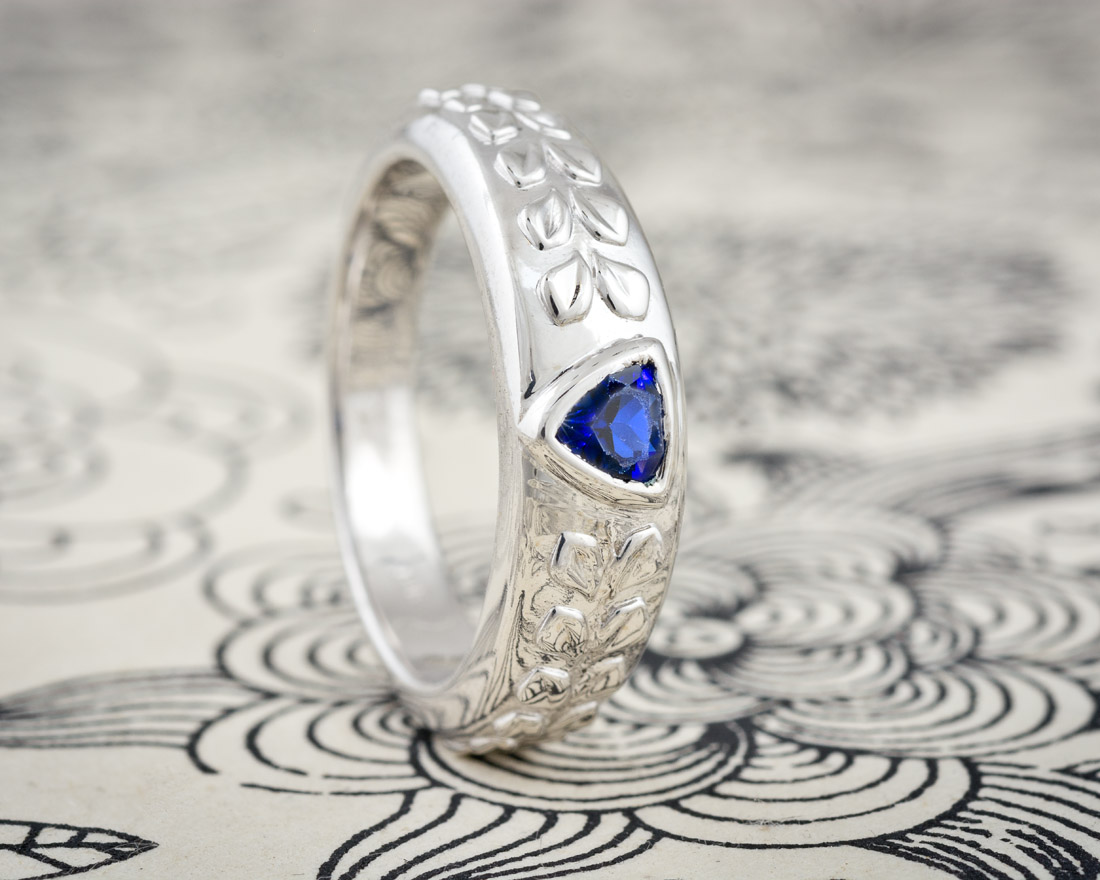 Mens wedding band with triangular sapphire