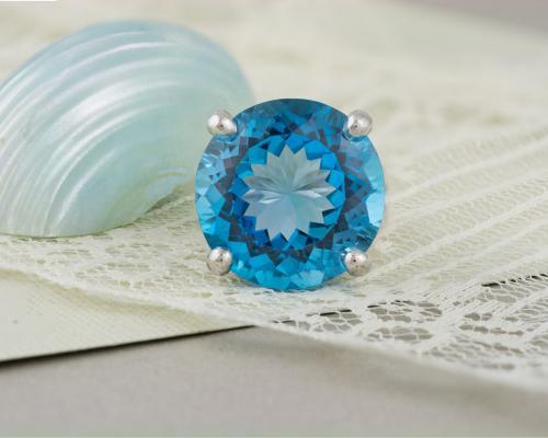 Blue Topaz Solitaire Split Shank Ring