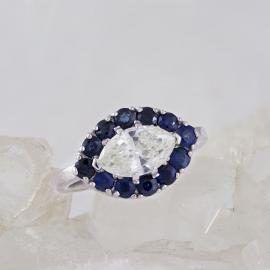 Marquise Diamond Engagement Ring with Sapphire Halo