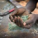 East African gem miner holding rough gemstones