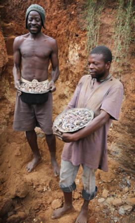 East African gem miners holding buckets of rough gemstones