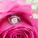 Custom diamond halo engagement ring in rose flower